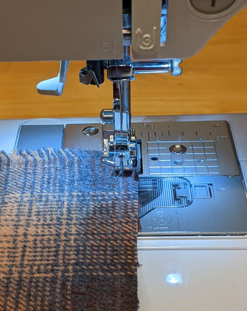 Sewing a straight stitch along marked line