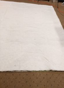 Cutting polyester batting to size of panels