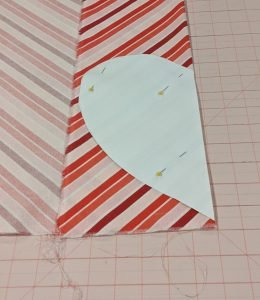 Cutting out heart pocket on the fold, using template