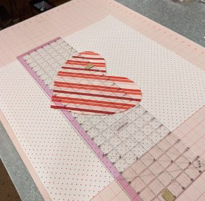 Placing heart pocket onto front of pillow