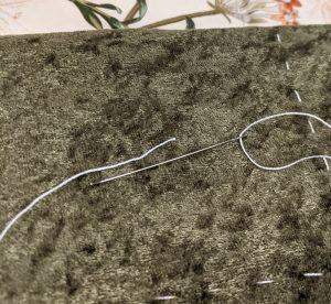 Needle & thread on quilt