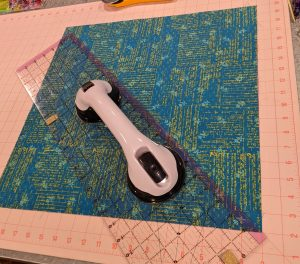 Cut 18 inch square across diagonal/bias