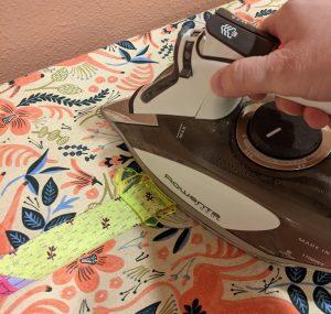 Slide tool down strip using iron